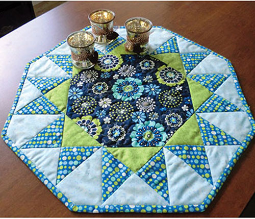 Quilt a burst of color for your kitchen with this fabulous table topper.