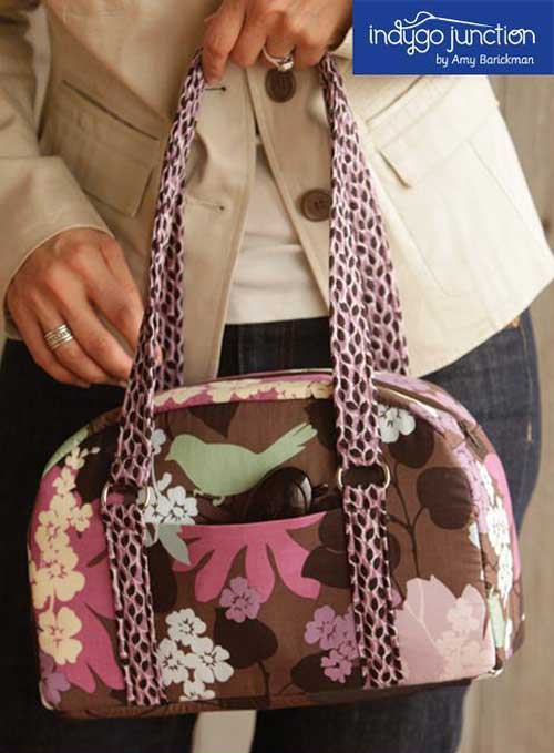 This bag is easy to make and features an outside pocket, double handles, and a zipper closure.