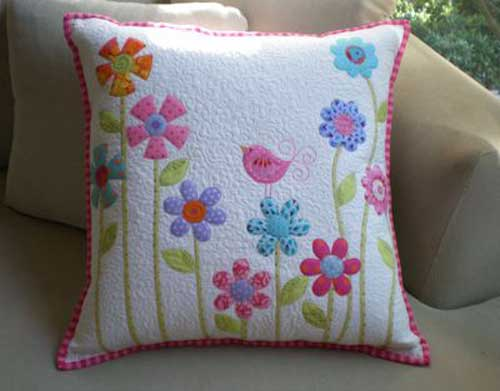 This cute quilted pillow is easy to make using simple shapes and fusible raw edge applique.