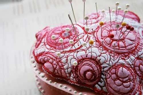 Learn how to take a plain heart-shaped candy box and upcycle it into a pincushion.
