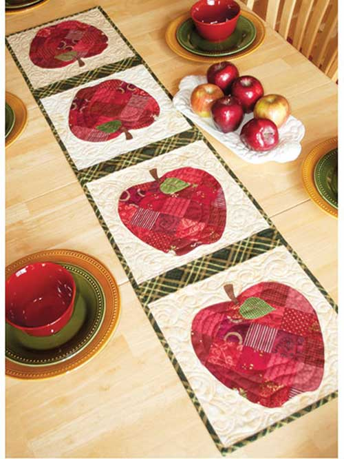 This cute patchwork table runner is perfect for your kitchen tabletop, or to give as a gift.