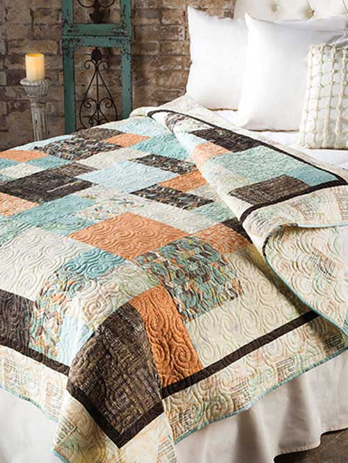 This fat quarter friendly quilt is quick and easy to make and is perfect for a beginner.