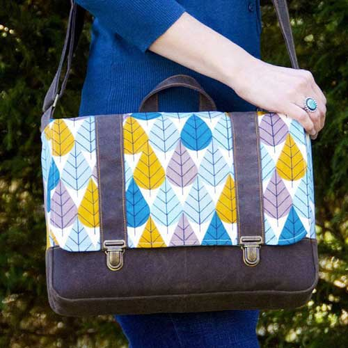 This bag has a classic messenger bag style with lots of extra details.