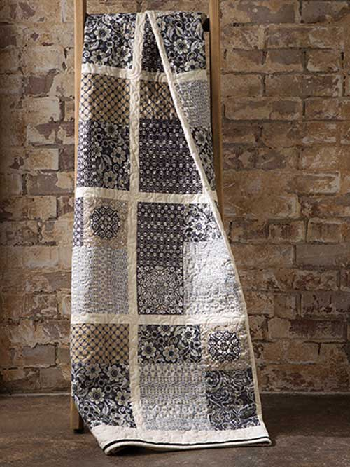 This quilt is easy to make by twisting and turning the four-patch blocks.