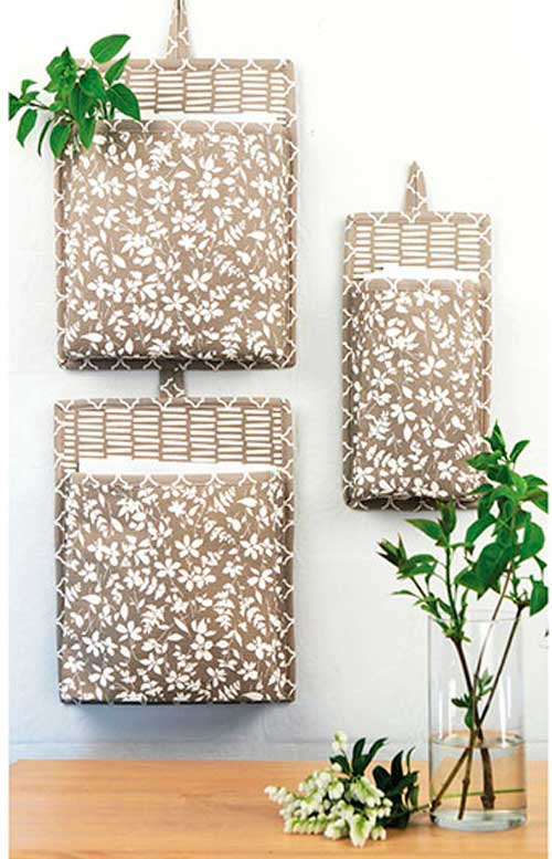 Store and organize your loose scissors, tape, notes and more with these fabric wall buckets.