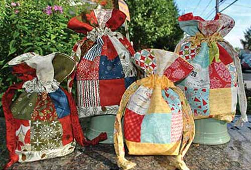 Create this pretty and functional drawstring bag using fabric scraps or your favorite charm squares.