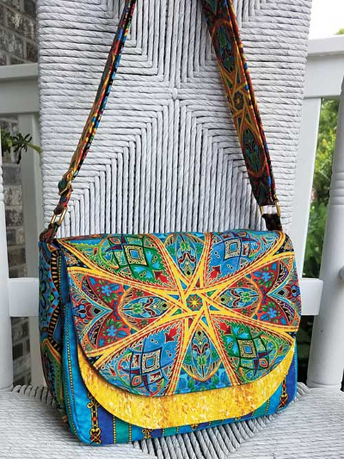 The bag flap is the perfect shape for expressing your creativity using piecework, applique, embroidery, fussy-cutting or your favorite coordinating prints.