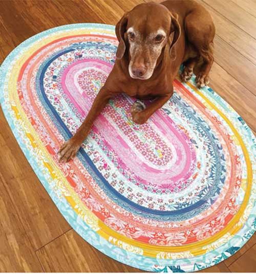 Make an easy floor rug with this pattern using only one Jelly Roll.