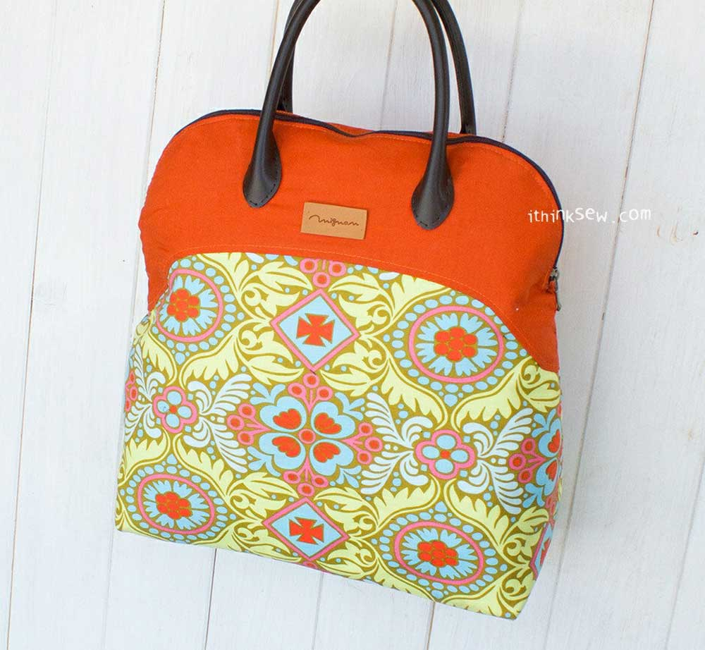 This bag has a curved top section which creates a large opening so you can easily see the contents of the bag.